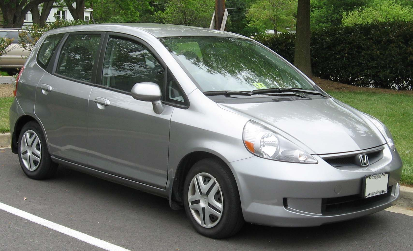 Honda Fit. I500cc Estimated to go 18KM on a liter of Petrol