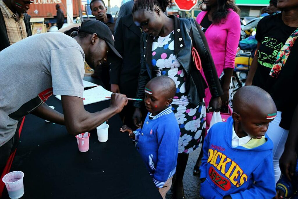 kids face painting at the peace si option campaign Eldoret