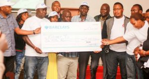 Team Buzeki hands over a 1 million cheque to Eldoret 7s Co