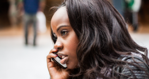 Woman using Safaricom reverse call feature