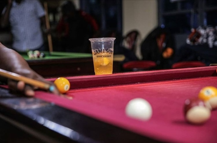 A jameson tumblr on a pool table