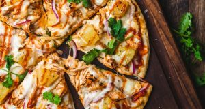 Pizza, a clove of garlic and an onion
